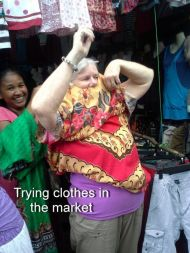 Trying clothes in the market