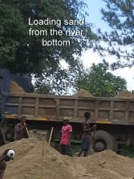 Loading sand from the river bottom